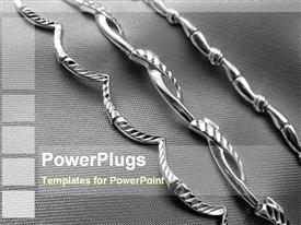 PowerPoint template displaying three decorated silver straight chains on an ash colored background