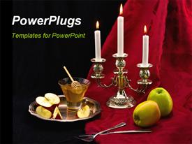 PowerPoint template displaying two apples beside a candle stand to celebrate the Jewish holiday