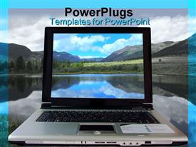 PowerPoint template displaying laptop close up with background of hills and lake