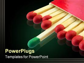 PowerPoint template displaying match box with matches with red heads and one match with green head on reflective black surface