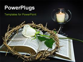Crown of thorns and a white rose on an open Holy Bible powerpoint design layout