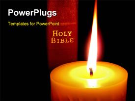 PowerPoint template displaying red Holy Bible Lighted by a Glowing Gold Candle