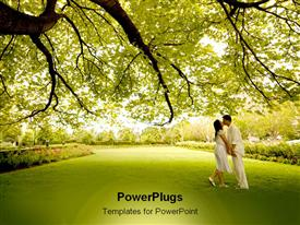 PowerPoint template displaying couple embracing under a big beautiful tree during spring in the background.