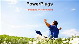 PowerPoint template displaying freedom - Man working with laptop in a meadow of flowers with copy space