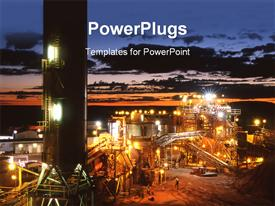 PowerPoint template displaying mining plant with lights on at dawn