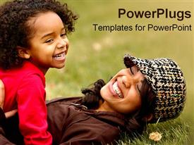 African American mother plays with her daughter in the grass powerpoint template