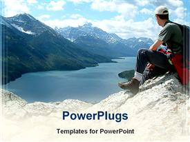 PowerPoint template displaying man sitting on top of mountain