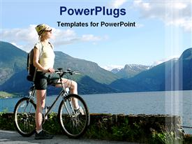 PowerPoint template displaying a cyclist enjoying the view with mountains in the background