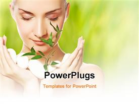 PowerPoint template displaying beautiful young woman holding plant growing up through stones in the background.