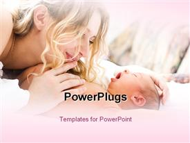 PowerPoint template displaying a happy mother cuddling her cute newly born baby