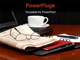 PowerPoint template displaying desk with laptop ring binder newspaper glasses and a cup of coffee in the background.