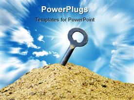 PowerPoint template displaying a key burried in the sand with sun in the background
