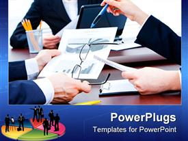 PowerPoint template displaying close up of business meeting with hands of company workers discussing around the desk, eyeglasses, pie chart on paper, pencils, laptop