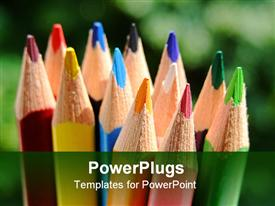 PowerPoint template displaying close-up of some colored pencils over a green background