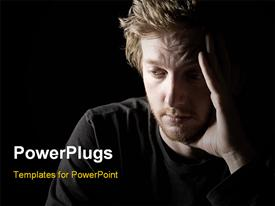 PowerPoint template displaying low key shot of a depressed red headed male with black color