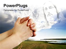 PowerPoint template displaying pair of hands in a praying position set against jesus with beautiful landscape