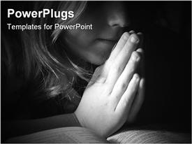 PowerPoint template displaying black and white depiction of a child praying in the background.