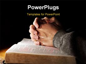 PowerPoint template displaying hands of a man praying in solitude with his Bible and black color
