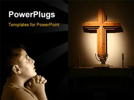 PowerPoint template displaying low key portrait of a boy praying in the dark in the background.