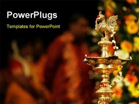PowerPoint template displaying prayer lights at an Indian wedding in the background.