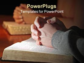 Husband and wife praying together with their Holy Bibles powerpoint template