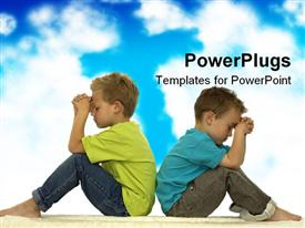PowerPoint template displaying two young boys praying while sitting back to back cloudy blue sky