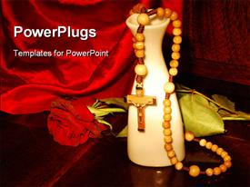 Praying beads with a rose and vase on a red cloth background powerpoint design layout