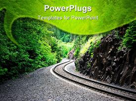 PowerPoint template displaying railroad tracks curving through a mountain canyon in spring