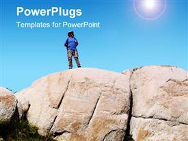 PowerPoint template displaying hiker stands alone after reaching the top of a large granite mountain