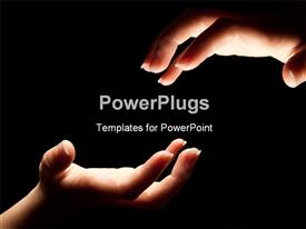 PowerPoint template displaying two hands reaching in the darkness to touch with black color