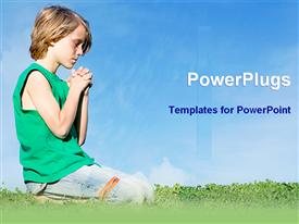 PowerPoint template displaying boy praying to Christ