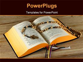 PowerPoint template displaying a holy bible with a number of beads in the background