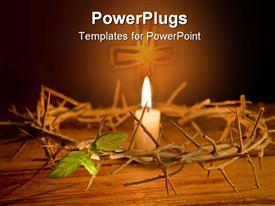 Candle burning in the middle of a crown of thorns at Easter powerpoint template
