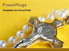 PowerPoint template displaying silver Jesus on gold cross with pearls on yellow background