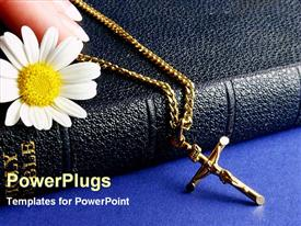 PowerPoint template displaying close up of Holy Bible cover with white flower and hand holding necklace with holy cross Jesus Christ on cross
