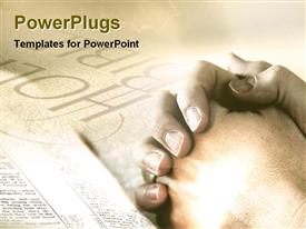 PowerPoint template displaying preying with holly bible in the background.