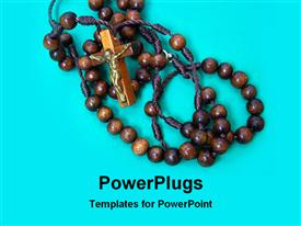 PowerPoint template displaying a brown rosary with a cross on a blue background