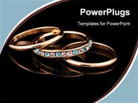 PowerPoint template displaying a beautiful depiction of gold rings with dark background