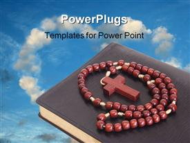 PowerPoint template displaying red rosary coiled on top of a book with blue sky