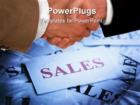 PowerPoint template displaying business concept with handshake over cards that say sales