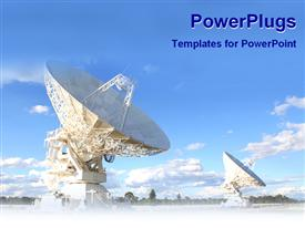 PowerPoint template displaying two huge white satellite dishes on field under blue sky
