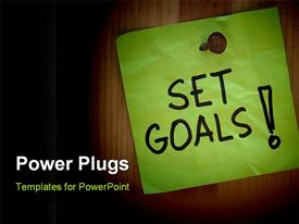 PowerPoint template displaying set goals - motivational reminder on post note nailed to wooden plank or wall