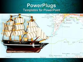 PowerPoint template displaying model of ship on background of map in the background.