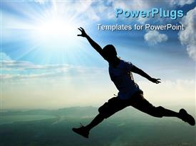 PowerPoint template displaying man jumping atop a mountain