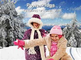 Two girls bundled in winter wear enjoying the snow template for powerpoint