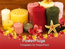 PowerPoint template displaying beautifully arranged spa essentials of towels, scented candles and flowers
