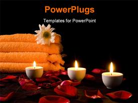 Candles and flowers before towel at night powerpoint theme