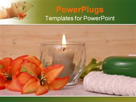 PowerPoint template displaying towel flower candle beside a glass cup with a candle