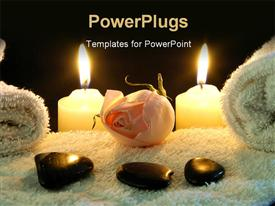 PowerPoint template displaying spa table with stones on white towel and two lighted candles