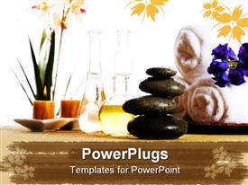 PowerPoint template displaying spa products with stones towels flasks and oil
